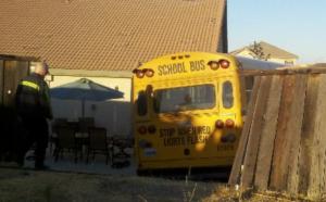 Auburn 300x186 School bus rolls into Auburn backyard